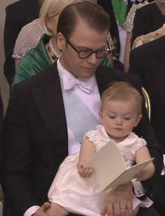 Princess Estelle 'reading' the program at her Aunt (Princess) Madeleine's wedding!!  She's just too stinkin' cute!