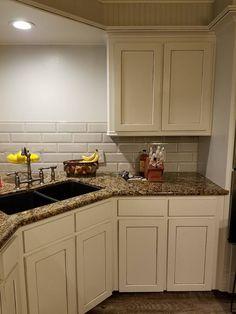 white kitchen cabinets baltic brown granite countertop tile