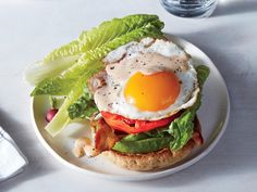 The addition of avocado, a fried egg, and smoky mayonnaise add enough heft to an open-faced BLT sandwich to make it dinner-worthy fare. W...