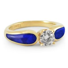 "This unique engagement ring - ""Midnight Sea - Radiance"" - features a .70 carat Diamond and Lapis Lazuli inlay set into 14k yellow gold. The vibrant blue and yellow gold create a striking exotic look that's hard to resist."