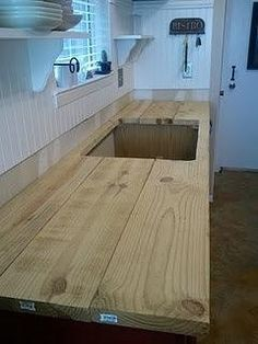 DIY wood countertop. Just stain and put some resin on it