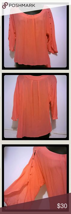 Anthropologie salmon blouse It is longer to the left side. Pleated in the front and back buttons down the sleeves. There is a small spot on the sleeve. Make an offer Anthropologie Tops Blouses