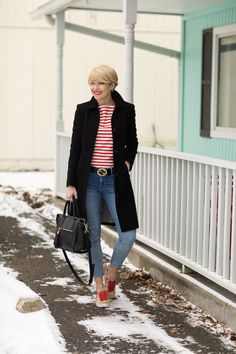 Seersucker and Saddles. White and red striped tee+cropped denim+leopard printed sneakers with a red ribbon+black long coat+black tassel shoulder bag+black Gucci belt. Winter Casual Outfit 2017