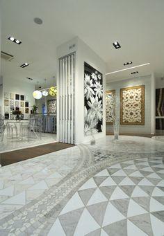 Pavimento intarsio ceramica e marmo. Showroom www.stanzedautore.it
