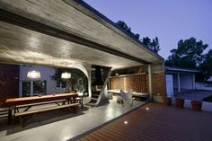 """Summer House in Argentina Defined by Twisted Concrete Columns - http://www.interiorredesignseminar.com/interior-design-inspirations/summer-house-in-argentina-defined-by-twisted-concrete-columns/ -                Located on the shores of a Patagonian lake in Rio Negro, Argentina, this summer house by NE-AR is a redesign of an existing dwelling on the site. According to the architects, the interior space was characterized by """"a deep dark dinning- living area with limited rela"""