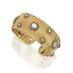 18 KARAT GOLD AND DIAMOND CUFF BRACELET, BUCCELLATI The hinged textured gold bangle applied with gold plaques set with old European-cut diamonds weighing approximately 3.80 carats, gross weight approximately 28 dwts., internal circumference 6 1/8  inches, signed M. Buccellati.