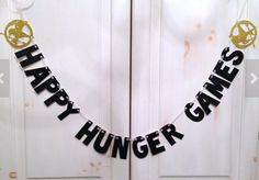 """Gifts for Teen Fans of The Hunger Games Catching Fire:  """"Happy Hunger Games"""" Glitter Banner by Hawthrone Avenue @ Etsy"""