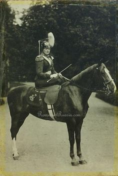 photograph of Empress Alexandra Feodorovna wearing the uniform of Colonel of the Life Guard Uhlan (Lancer) Regiment that bore her name. The photograph was taken on May 15, 1903 during the celebration of the 200th anniversary of the regiment at Peterhof.