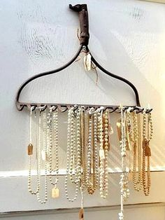 Use an old metal rake to organize our jewelry and top it off with that old 1980's western belt buckle.