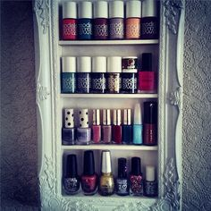 Framed wall shelving for Nail polish. nice way to turn storage into something more