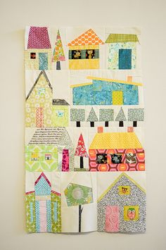 absolutely love how bright & cheerful this is! - using the paper pieced houses pattern from a different pin (Johanna Masko : Houses! A Foundation Paper Piecing Design ) Mini Quilts, Small Quilts, Baby Quilts, House Quilt Block, House Quilts, Quilt Blocks, Fabric Houses, Quilting Projects, Quilting Designs