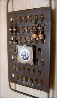 Old cheese grater repurposed for pierced earrings.
