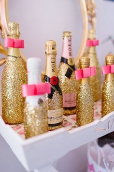 When life hands you glitter, decorate champagne bottles with it.