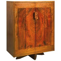 George Nakashima Walnut Cabinet with Burl Pull, USA, 1991 | From a unique collection of antique and modern cabinets at https://www.1stdibs.com/furniture/storage-case-pieces/cabinets/