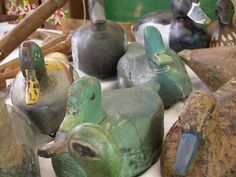 Old hand-carved duck decoys at a brocante fair in the Dordogne