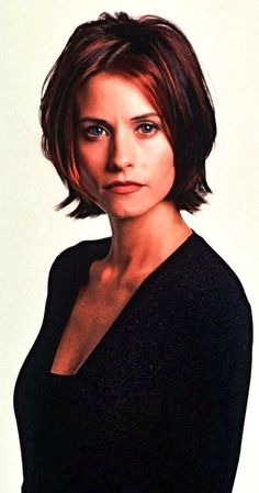 Courteney Cox as Monica E. Geller-Bing