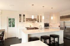 White cabinets, dark floor, marble backsplash
