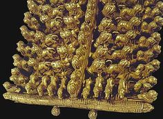 Etruscan art detail gold fibula. C.450BC