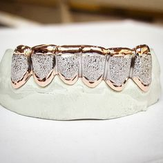 Hope everyone has a great weekend. Bottom Laser cut rose gold setup! Your source for #gold #grillz and #custom #jewelry in #centex!  #killeen #forthood #waco #copperascove #belton #waco #temple #welcomehome #troops #lasercut #boxcut #punchout #diamond #cut #trillion #laser #slugs #solid #openface #caps #GoldTimeKilleen  #military discounts and financing options available. $0 DOWN  LOW PAYMENTS!  Goldtimekilleen@gmail.com 254.519.GOLD (4653) by goldtimekilleen