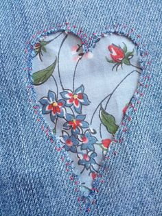 I just stitched a small heart of material into my jeans...will get better when washed a few time...the fabric was cut from one of my old dresses