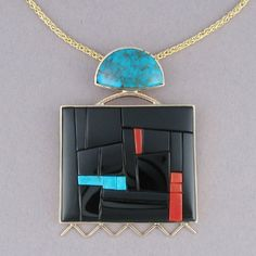 "14K Gold Pendant with Inlay  Item: IJ5301  Material: 14k gold, Edwards black jade, Candelaria turquoise and coral  Size: 2 1/8"" x 1 1/8"" pendant, 17 1/2"" 14k gold chain  Period: contemporary  Origin: San Felipe Pueblo  Artist: Richard Chavez  Price: $5,800.00"