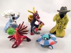 """Twelfth batch of 2"""" Monsters. Includes the Mi-go, Heavy Metal Banshee, Krampus, Mothership, and the Invisible Man."""