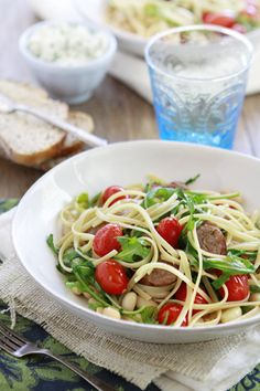 Linguine with tomatoes, white beans, arugula, and Italian Sausage