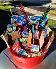 graduation gift basket!   DIY: decorative basket, floral styrofoam base, multicolor popsicle sticks, favorite gift cards, lotto tix, mini liquor bottles, candy and tinsel! Graduation Gifts, Graduation Ideas, Styrofoam Crafts, Mini Liquor Bottles, Best Gift Baskets, Anniversary Decorations, Summer Gifts, Welcome Gifts, Basket Decoration