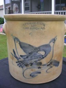 "Four gallon stoneware crock stamped ""Ottman Bros & Co., Fort Edward, NY,"" H 11 1/2"""