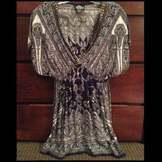Tunic Shirt Really cute tunic type shirt. Gold accents along neck line. Perfect for fall and winter with leggings. Angie Tops Tunics