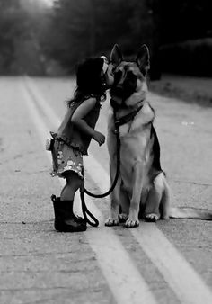 kiss of a tender heart to her protector ..not just her pet but her family...........