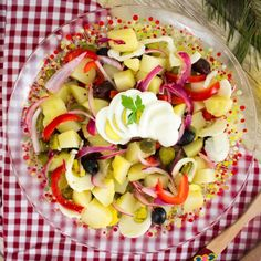 A traditional Romanian winter salad with potatoes, eggs, pickles, olives and red onion, with a simple vinegar and oil dressing.