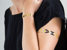 This temporary tattoo jewelry, discovered by The Grommet, helps you accessorize in an instant with necklace, armband, and cuff metallic tattoos.