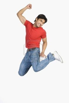 Man jumping in mid-air Stock Photo
