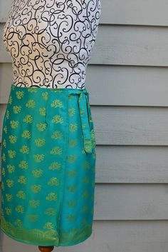 My new favorite skirt pattern! The darts give this easy-to-sew skirt amazing shape. I used cotton and added two inches for a hem allowance. I whipped this up in one afternoon, and am looking forward to making several more.   Simple Simon & Company: Skirting the Issue: LiEr from ikatbag. Wrap skirt with darts for a flattering fit.