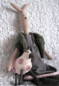 Romantic, pink lamb, accompanied by pink-gray rabbit.