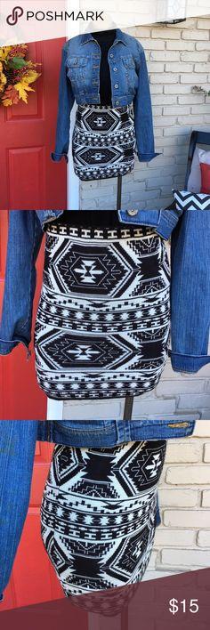 F21 black white aztec sweater skirt Elastic waist black white aztec sweater skirt. Pairs great with tights! Size Medium (Junior-Forever 21). Runs small Forever 21 Skirts