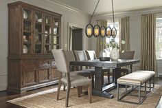 Strumfeld complete dining set with ample upholstered seating and china cabinet/buffet combo