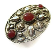 Vintage carnelian glass brooch, with flowers, teardrops and twisted wire decoration, silver tone metal, round cabochons, shield like pin. https://www.etsy.com/listing/264674808/vintage-carnelian-glass-brooch-with