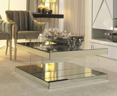 Let your living corner filled with unbounded enchantment by going for one out of these 7 fascinating modern coffee table ideas. They gravely lift the sophistication of your interior designs to the next level. Mirrored Coffee Tables, Coffee Table With Drawers, Unique Coffee Table, Coffee Table Styling, Glass Top Coffee Table, Contemporary Coffee Table, Coffee Table Design, Modern Coffee Tables, Round Coffee Table