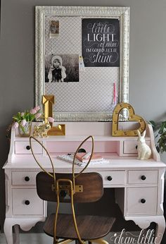 We created a fun little pinboard for this room by adding some corkboard covered in fabric and popping it inside this old frame. It's a fun accent to this bunny eared chair and vintage style pink desk.