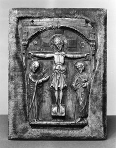 This ivory plaque depicts Christ's crucifixion with Mary and St. John the Evangelist mourning at either side of the cross. The plaque was originally the center of a triptych. 2nd half 10th century (Medieval)