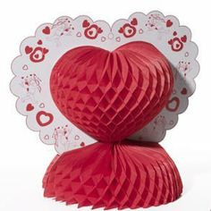 """Sale Heart Tissue Centerpiece Sale by Century Novelty. $1.99. Love is in the Air with Valentine's Day Decorations! The Heart Tissue Centerpiece is the perfect way to decorate for your Valentine's Day party. 13"""" tall. 10 1/4"""" wide tissue base folds out. Made of cardstock and tissue. Be sure to put love in the air with Valentine's Day Decorations. The decorating is not complete until everything is red, pink and purple. We have the Valentine's Day party decorations you need to..."""