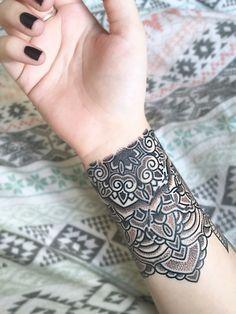 Mandala wrist tattoo (Artist Matt Stopps at One by One Tattoo Studio in Soho, London).
