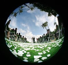 Love this shot! Think outside the box, use a fisheye lens for wedding photo.