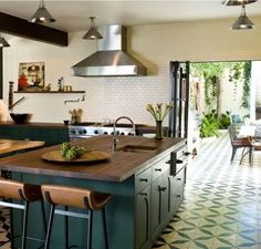 Gorgeous kitchen, from tiles to cabinets to colors to floors. (And the exterior dining area doesn't hurt, either.)