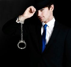 Neal Caffrey. One of my 2011 fashion icons. He is class and charm personified. In handcuffs.