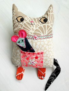 On the lighter side -  mini cat with mouse finger-puppet.