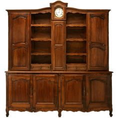 Antique French Walnut Louis XV Vaisselier with Clock, circa 1820 | From a unique collection of antique and modern cupboards at https://www.1stdibs.com/furniture/storage-case-pieces/cupboards/