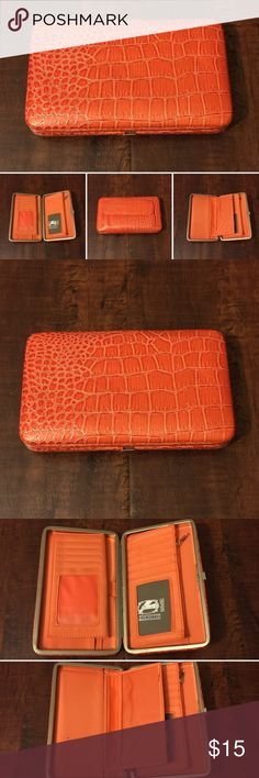 "8. Orange Hananel Wallet Hananel Wallet  Perfect wallet for the gal on the go!  Colorful, compact and convenient.   Measurements are 7.5"" length x 1"" width x 4.5"" height.   Sturdy metal frame with easy-open clasp. Multi-function interior accommodates ID photo window, credit card slots, cash, checkbook holder!    Product Features: Sleek, unique & chic wallet Superb full-frame design & stylish exterior Opens easily & lies flat to allow easy access Zippered pouch Pocket on the back of wallet…"